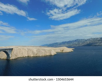 Pag Island, Croatia, The Pag Bridge, beautiful picture of the great construction, yellow rocks and blue sea.