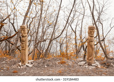 Pagan idols in autumn forest