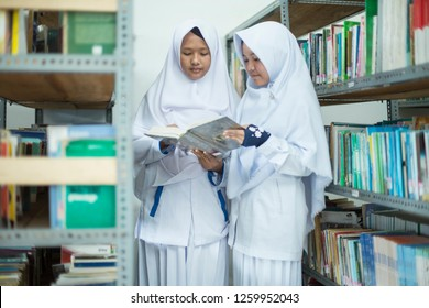 Pagaralam, South Sumatra, 21/11/18, two female students were reading books in the Dempo Darul Muttaqien Islamic Boarding School library, Pagaralam.