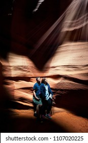 PAGE, ARIZONA, USA -  Tourists enjoy Rays of sunlight within Upper Antelope Canyon on May 24, 2015 in Page AZ,USA. Thousands of people from all over the world come to visit Upper Antelope Canyon.