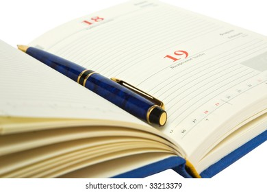 Page of diary with pen inside, isolated on white