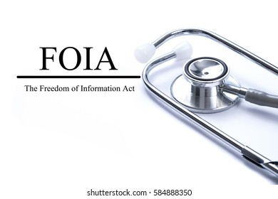 Page with FOIA (The Freedom of Information Act) on the table with stethoscope, medical concept.