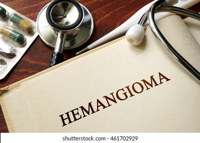 Page with word Hemangioma and glasses. Medical concept.