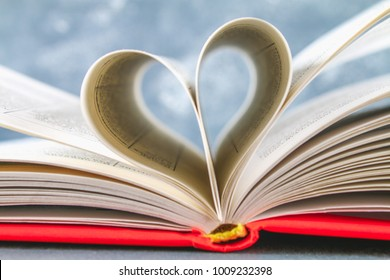The pages of the book in the red cover are made in the form of a heart. The concept of Valentine's Day