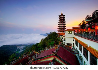 Pagoda at Chin Swee Temple, Genting Highland is a famous tourist attraction near Kuala Lumpur. Carpet clouds with a blue hour Sunrise. Image has grain or blurry or noise when view at full resolutions.