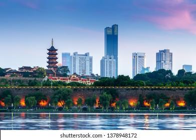 Pagoda and city walls on the shores of Xuanwu Lake, Nanjing, China.