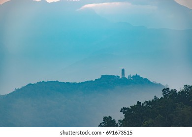 Pagoda on hill with sunrise in blue background