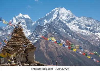 Pagoda with prayer flag with view of snow mountains. Nepal