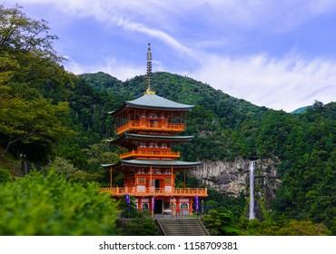 The pagoda of Seigantoji and Nachi no Taki waterfall (highest waterfall in Japan) with blue sky in Wakayama, Japan