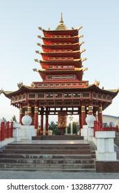 """Pagoda Seven Days, Elista, Kalmykia, Russia with Buddhist prayer wheel with mantra sounds """"Om mani padme hum""""."""