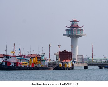The pagoda style lighthouse at the harbour of Ko Sichang, an island off the coast of the Chonburi Province in Thailand. Ko Sichang is a centre of commercial shipping and tourism.