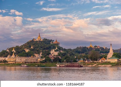 Pagodas gleam on the serene riverbanks of the Irrawaddy in Myanmar