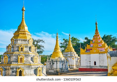 The pagodas of Nget Pyaw Taw Paya complex have carved decors, painted details and topped with ringing hti umbrellas, Pindaya, Myanmar