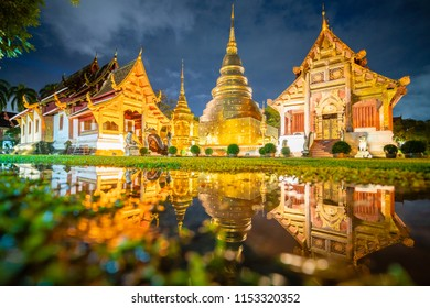 Pagodas and Ordination hall reflecting in water, Wat Phra sing (singh) oldest temple in Chiang Mai ,Thailand.