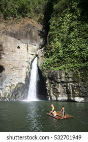 Pagsanjan Falls, Philippines - Apr 26, 2007: Tourists on rafts pulled through Pagsanjan Falls, Philippines. The most famous waterfalls in the Philippines an attraction since the Spanish Colonial Era.