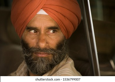 Pahalgam, Jammu and Kashmir, India - August 02, 2011: Sikh man driving in the traffic of Pahalgam, Indian city in the Himalaya range near Pakistan border
