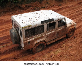 PAHANG, MALAYSIA - 1 Jun 2015 : Four wheel drive vehicles passing a muddy road in Malaysia rainforest in Ulu Tembeling.