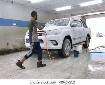 Pahang, Malaysia - 23 October 2017 : New Hilux Revo model in car wash after off road in mud train in Pahang, Malaysia.