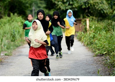 PAHANG, MALAYSIA - 29TH FEBRUARY 2016 : A group of school children running while participatin in mini marathon and short distance cross country running.