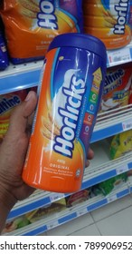 Pahang, Malaysia - 3rd January 2018 : Hand hold a Horlicks bottle in the supermarket