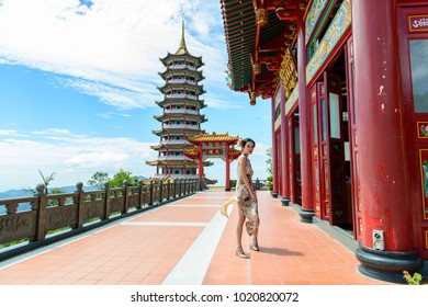 Pahang, Malaysia - 6th February 2018 : A portrait of chinese girl wear Qipao, a chinese style cheongsam in conjunction of Chinese New Year festival - illustrative editorial.