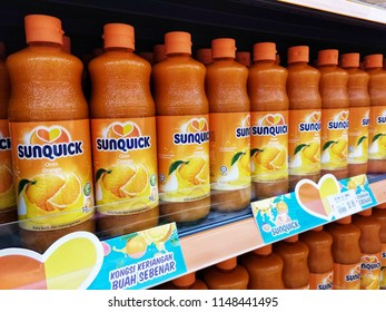 Pahang, Malaysia - 9 July 2018 : Line of SUNQUICK bottle's fruit juices flavour orange display for sell in the supermarket shelf.