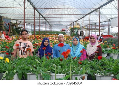 PAHANG, MALAYSIA - August 10, 2017: undentified family poses at flower farm background in Cameron Highland, Malaysia.