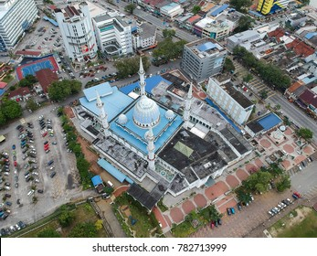 Pahang, Malaysia - December 28, 2017 : Aerial view of Sultan Haji Ahmad Shah Mosque, the largest mosque in Pahang State with beautiful Kuantan city as background.