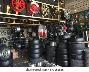 PAHANG, MALAYSIA - FEB 02, 2017 : The interior of vehicle tires shop with a lot of brand, pattern of tires and rims.