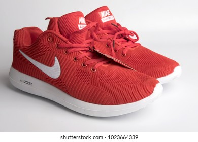 Pahang, Malaysia - February 9, 2018 : Product shoot of red Nike men's running shoe. Isolated over white background