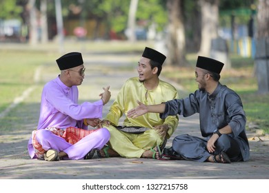 PAHANG, MALAYSIA - JULY 14TH 2017 : The Malay adult wearing Malay traditional cloth or Baju Melayu showing their happiness reaction in Eid Fitri or Hari Raya.
