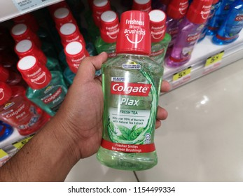 PAHANG, MALAYSIA - June 29, 2018: Man's hands are buying effective mouthwash in a supermarket.Colgate Plax Mouthwash on supermarket shelf. Colgate offering a diverse range of oral hygiene.
