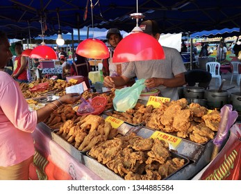 PAHANG, MALAYSIA - MARCH 20TH 2019 : Street scene at evening market or night market. Crowd of people walking around at pasar malam vendor. Motion blur.