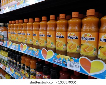 Pahang, Malaysia - MARCH 2ND 2019 : Line of SUNQUICK bottle's fruit juices flavour orange display for sell in the supermarket shelf.