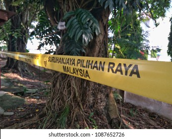 PAHANG , MALAYSIA - MAY 9, 2018 : Yellow barrier tape of the Malaysian election commission at a polling station for the Malaysian 14th general election on May 9, 2018 in Pahang , Malaysia.