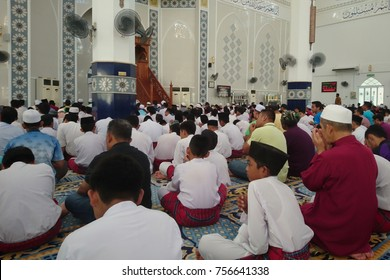 Pahang, Malaysia - November 17, 2017 : People pray and assembly for meat each other during friday noon.