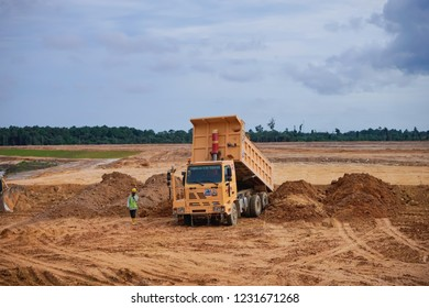 Pahang, Malaysia - November 2018 : A loaded dump truck ready to unload soil on construction site  in Kuala Lumpur Malaysia.