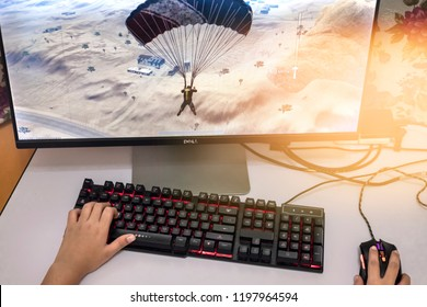Pahang, Malaysia - October 8, 2018: Gamer boy Playing in Multiplayer PC Video Games. PUBG is e-games famous in the world.