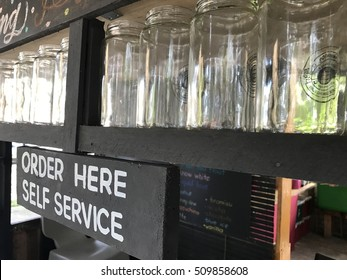 PAHANG , MALAYSIA - SEPTEMBER 04 , 2016 : ORDER HERE SELF SERVICE Sign at cafe akak lesung pipit in outer space rajawali art group.