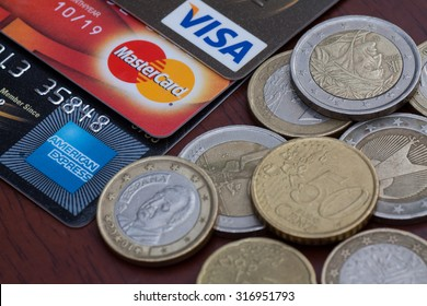 PAHANG , MALAYSIA - SEPTEMBER 15, 2015 - Illustrative Editorial,close up of credit cards , master card, visa and american express with euro coins on wooden background, product shot