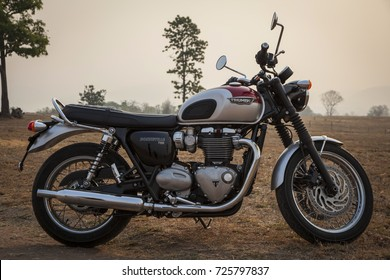 Pai District,Mae Hong Son,Thailand - April 28, 2016: TRIUMPH BONNEVILLE T120 1200CC ON THE FIELD IN THE MORNING SUNRISE ON APRIL 28,2016 IN PAI DISTRICT,MAE HONG SON THAILAND