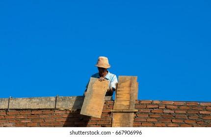 PAI, MAE HONG SON, THAILAND - DECEMBER 23 2009 : A man working at building a wall