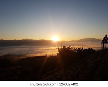 Pai, Mae Hong Sorn, Thailand on 28 November, 2018. A view of sunrise in the morning by there is fog sea. The sun is going up behind the mountains. Beautiful nature at North of Thailand.