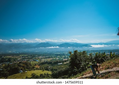 Pai, Thailand - August 11th 2019: Beautiful landscape of Pai, Thailand. Beautiful clouds and mountains in the background.