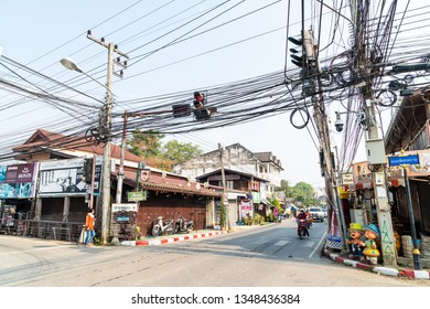 PAI, THAILAND - FEB 16, 2019 : Street scene in Pai, Thailand. During high season, tourist numbers swell to the point where Pai experiences as shortages of electricity, water and petrol.