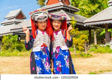 PAI, THAILAND - FEB 16, 2019 : Hmong children with nasal mucus,Portrait of H'mong(Miao) little girls wearing traditional dress during Lunar New Year holiday