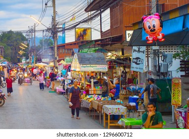 PAI, THAILAND - JAN 03, 2017: People walking on  Pai night market at twilight. Pai is the famous tourist attraction in Thailand
