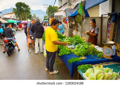 PAI, THAILAND - JANUARY 10, 2017: People buing fresh grocery at asian market at Pai city street