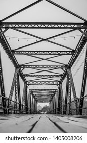 Pai, Thailand - March 22, 2019: Pai bridge, massive structure made of wood and metal. Black and white photo.
