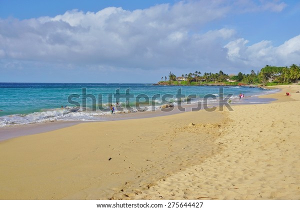 PAIA, HAWAII -2 APRIL 2015- The Paia Bay Beach, on the North Shore of the Hawaiian island of Maui, is a favorite of boogie boarders and body surfers.